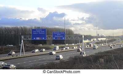 Motorway Traffic - Pan and zoom over a large motorway with...