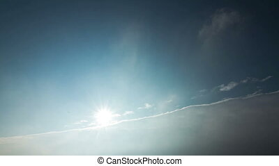 Sun Clouds - Time lapse of passing clouds and the sun in the...