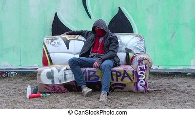 Graffiti Artist on Couch - Graffiti Artist, sitting on a...