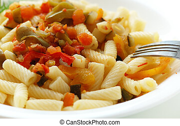 macaroni with vegetables on white plate