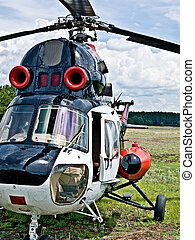 helicopter - Modern light  helicopter standing on a field