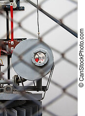 Gauge of a high voltage transformator shot trough the safety...