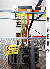 High voltage transformator with warning sign