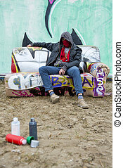 Hooded grafitti painter - Hooded figure of a toughly posing...