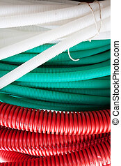 White, green and red cable hoses