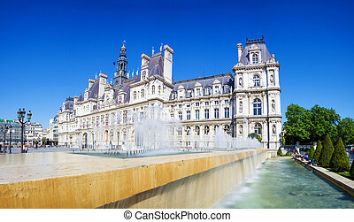 Panoramic photo of Paris City Hall (Hotel de ville) with fountains and blue sky