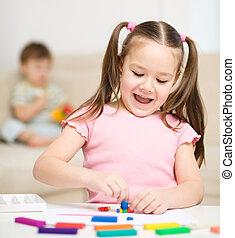 poco, niña, juego, Plasticine