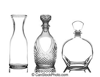 Decanters on White with Reflection - Closeup of three glass...