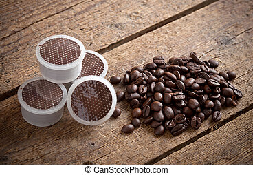 Coffee pods on wooden table