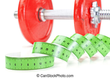 Green measuring meter and dumbbells for fitness. On a white background.