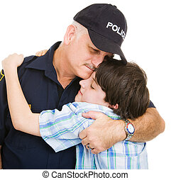 Police and Boy Hug - Policeman hugging an adolescent boy....