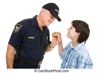 Police Community Relations - Adolescent boy giving a donut...