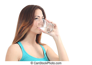 Woman drinking water from a glass on a white isolated...