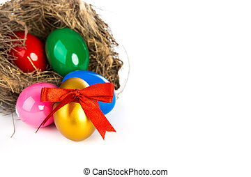 Colorful Easter eggs in a nest from branches on white...