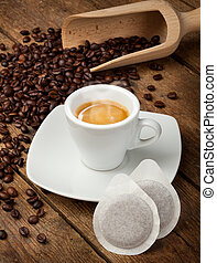 Coffee cups with pods on rustic table