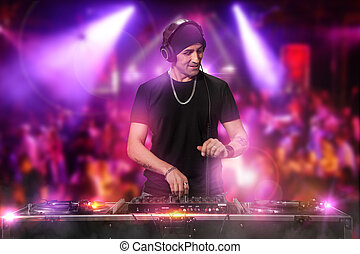 DJ is working at the disco - Photo of dj working at the...