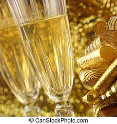 holiday card golden champagne and gift