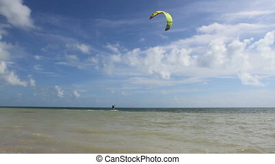 Kite Surfer - A kite surfer catches a gust and rides it in