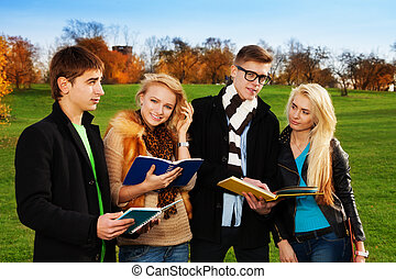 Two students couples in park with blond women happy and...