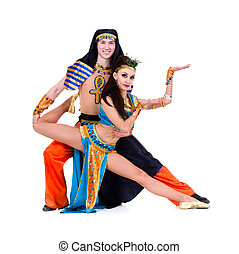 dancers couple dressed in Egyptian costumes posing