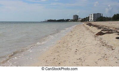 Resorts on Beach - An empty beach with hotels in the...