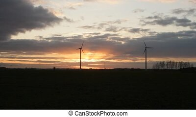 2 Wind Turbines in Sunset