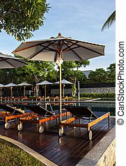 Holiday resort loungers - Image of luxury asian holiday...