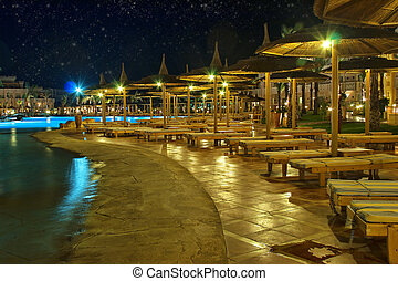 Luxury hotel at night - Panorama of luxury hotel pool at...