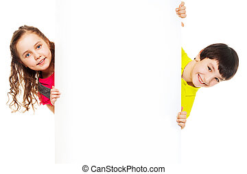 Two kids with blank ad board - Two kids, boy and girl...