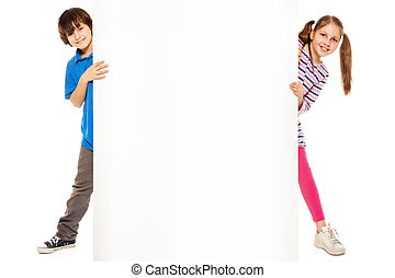 Two kids showing new blank advertising - Handsome boy and...