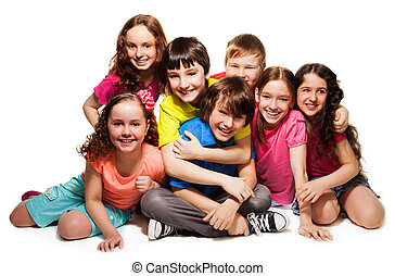 Group of happy hugging kids, laughing and smiling together...