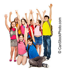 Group of happy kids lifting hands
