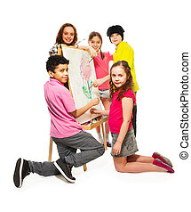 Kids painting - Group of four happy kids, boys and girls...