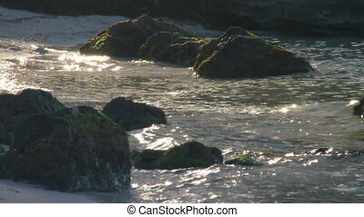 Waves on Rocks, SlowMo - Shot in 60p. Waves washing over a...
