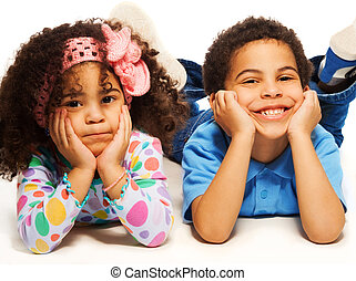 Happy siblings - Beautiful black brother and sister with big...