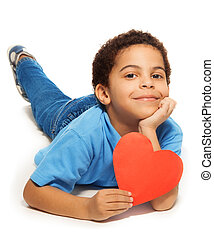 Cute five years old boy with heart symbol laying isolated on...