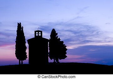 Chapel silhouette in Tuscany - Silhouette at sunset of a...