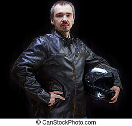 Adult motorcyclist in brown leather jacket. - Studio waist...