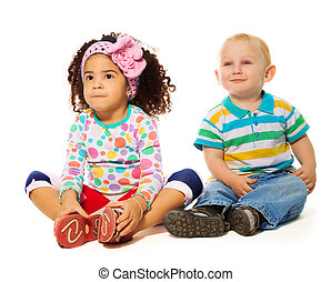 Adoring two years old couple - Black girl and Caucasian boy...