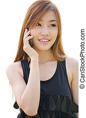 Teen Asian girl using cell phone - Closeup portrait of a...