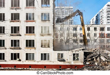 demolition of dilapidated and old apartment building in...