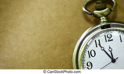 Antique pocket Watch - An antique pocket watch ticking, on a...