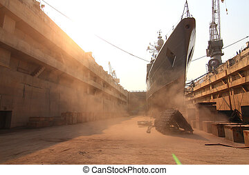 Sandblasting  inject Chain  in dry dock