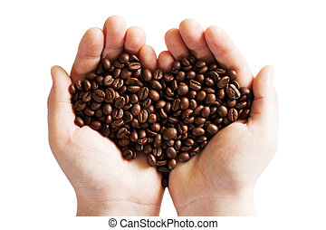Heart of cofee grains in hollow of the hand - Fresh roasted...