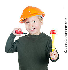 A little boy in a helmet with toy tools on white background