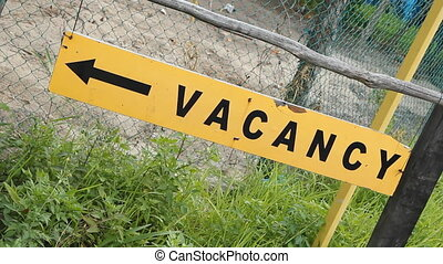 Vacancy sign Two shots - Sign indicating vacancy at a hotel...