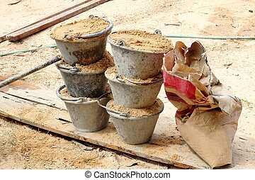 Sand in bucket for cement mixing