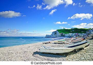 Etretat village, bay beach and boats. Normandy, France.