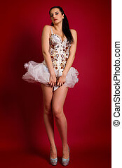 young girl in a white sexy dress on a red background