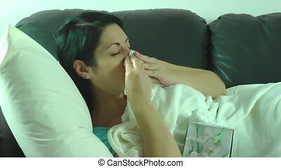 Sick sneezing woman having a cold